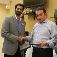 Hisham receiving special recognition award for highest volume increase