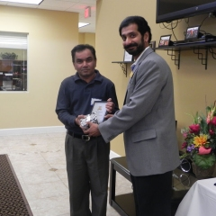 Pravin receiving special recognition plaque for highest score on Trimark of Excellence