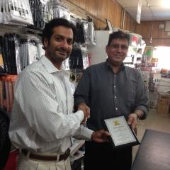 Mr. Kumar Shah receiving an award
