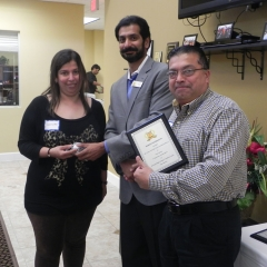 Neelam and Sal receiving special recognition plaque and gift for high scores on Trimark programs