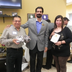 Sal & Neelam receiving recognition for highest MDA collection