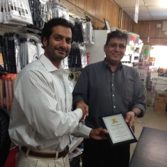 Mr. Kumar Shah receiving an award